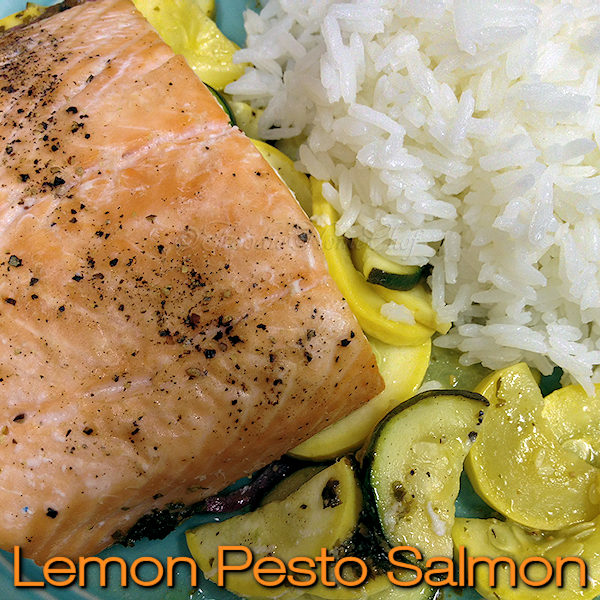 You're going to love this Lemon Pesto Salmon dinner by Foodie Home Chef. It's easy to make, can be prepped in advance & cleanup is almost non existent... oh & let's not forget it's delectably delicious! It's a family favorite recipe & once you try it, it will be one of your go to recipes especially on busy days. Lemon Pesto Salmon | Salmon Recipes | Seafood Recipes | Fish Recipes | Packet Recipes | Sheet Pan Salmon | Sheet Pan Recipes | Dinner Recipes | #foodiehomechef @foodiehomechef